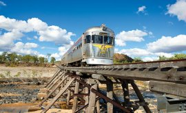 Silver Savannahlander train crossing a bridge