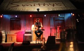 Entertainer on stage at Smithy's Outback Dinner and Show
