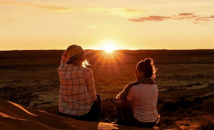 Women watching sunset on Big Red